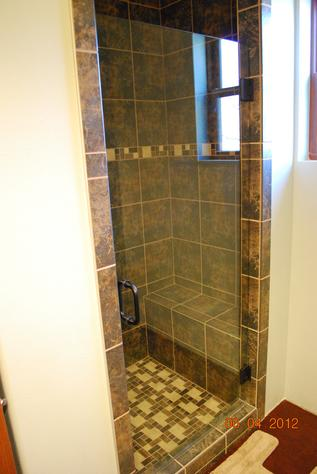 Glass shower door with handle